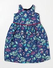 Vestido beba S/M en algodon estampado colores fuertes c/pom pom en cintura. Creaciones Nora.
