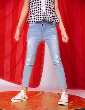 Pantalón jean localizado con roturas nena Hanna Olivia